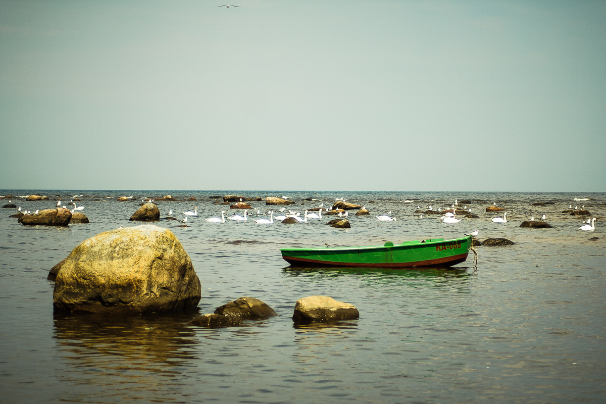 Green Boat And Rocks Via @Atisgailis