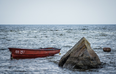 Red boat and rock