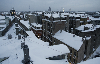 Snowy roofs of city